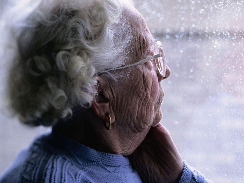 Elder Justice services - Photo of an elderly woman looking out a window