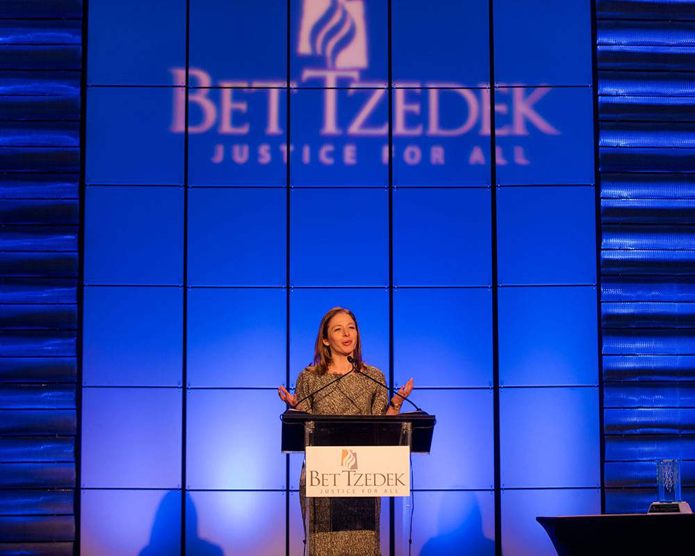 Special Events - Photo of Jessie Kornberg, CEO of Bet Tzedek, speaking at one of Bet Tzedek's special events