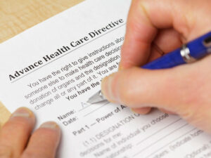 Advanced Planning - Photo of someone filling out an advanced health care directives form