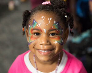 Bet Tzedek's Impact - Photo of a young girl with her face painted