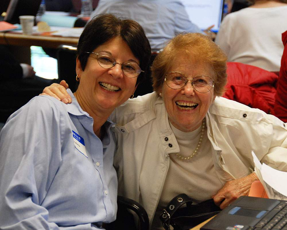 Bet Tzedek's Services - Photo of an elderly Holocaust survivor and a Bet Tzedek staff member