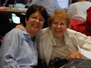 Holocaust Survivors Justice Network - Photo of an elderly Holocaust survivor with a Bet Tzedek staff member