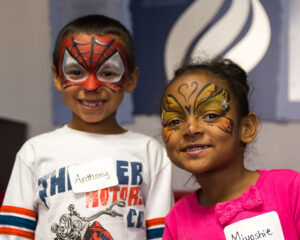 Kids in Need Services - Photo of two young children with their faces painted at a Bet Tzedek event