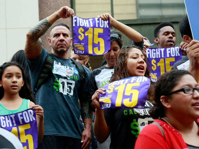 Workers Rights - Photo of activists protesting for a higher minimum wage