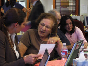 Wrap-Around Legal Services - Photo of an elderly Holocaust survivor talking with a Bet Tzedek lawyer
