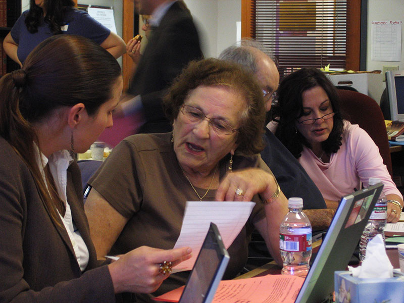 Wrap-Around Legal Services - Photo of an elderly Holocaust survivor talking with a Bet Tzedek lawyer
